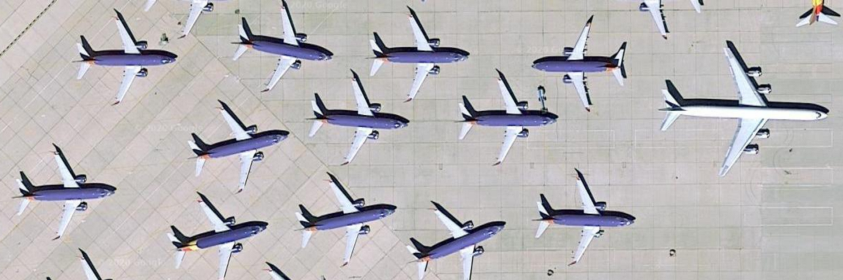 A group of airplanes parked on a runway