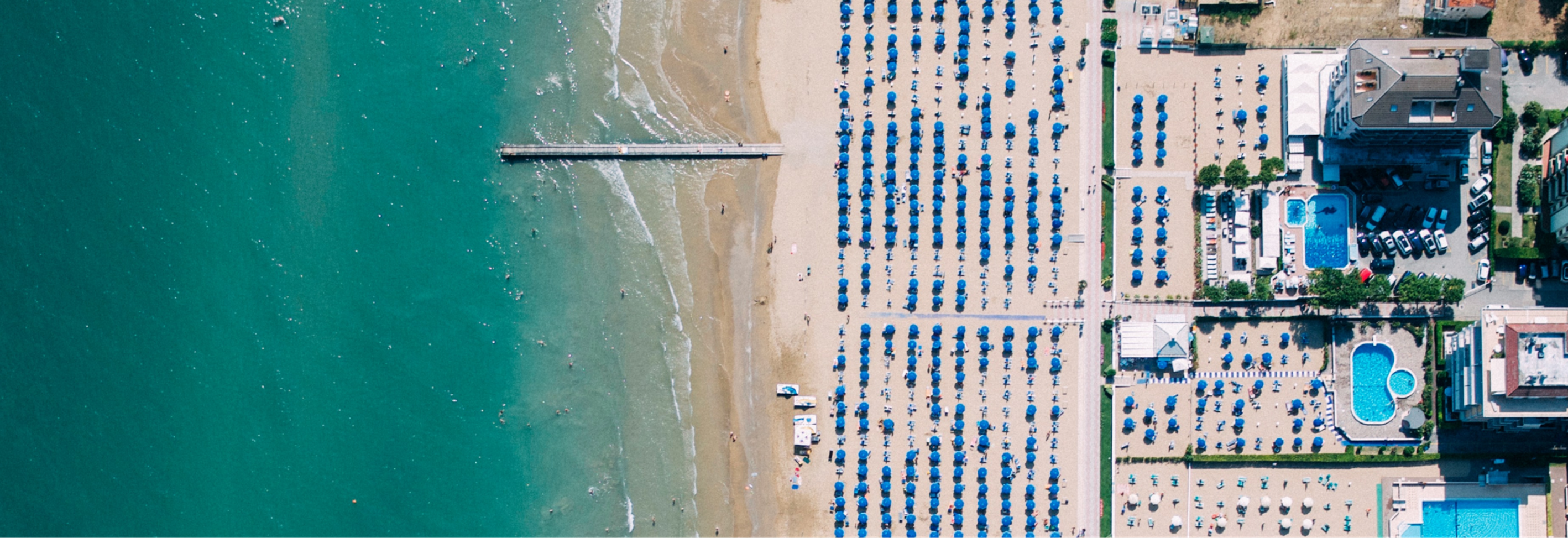 An overhead view of a beach meeting the ocean