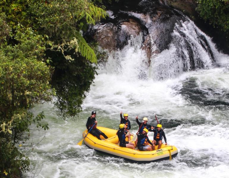 People river rafting on rapids