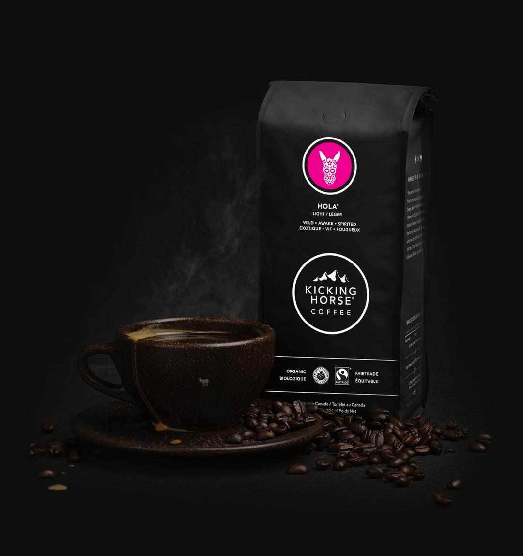 Hola Whole Bean Coffee bag with cup of coffee and coffee beans