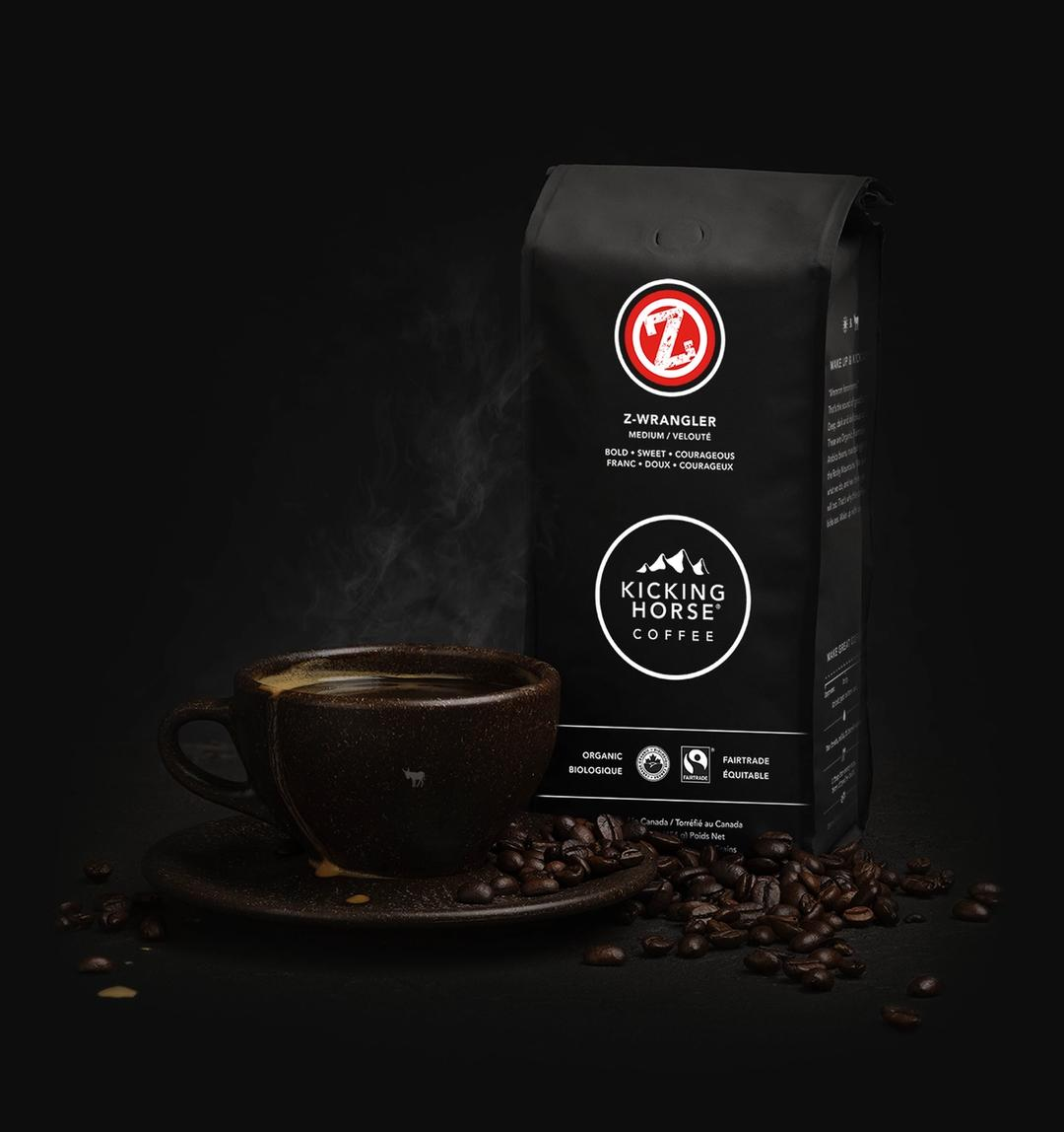 Z-Wrangler Whole Bean coffee bag with cup of coffee and coffee beans