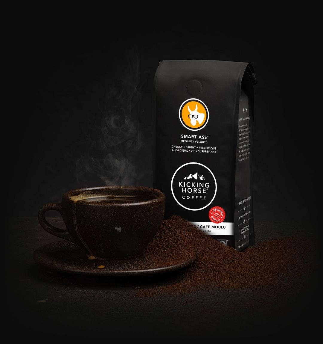 Smart Ass ground coffee bag with cup of coffee and coffee grounds
