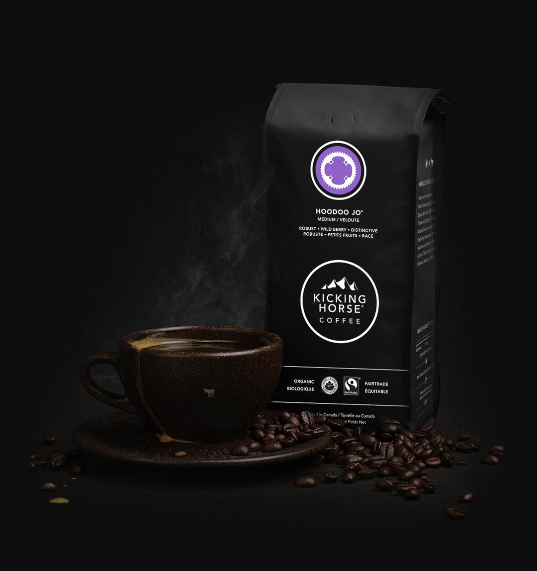 Hoodoo Jo Whole Bean coffee bag with cup of coffee and coffee beans