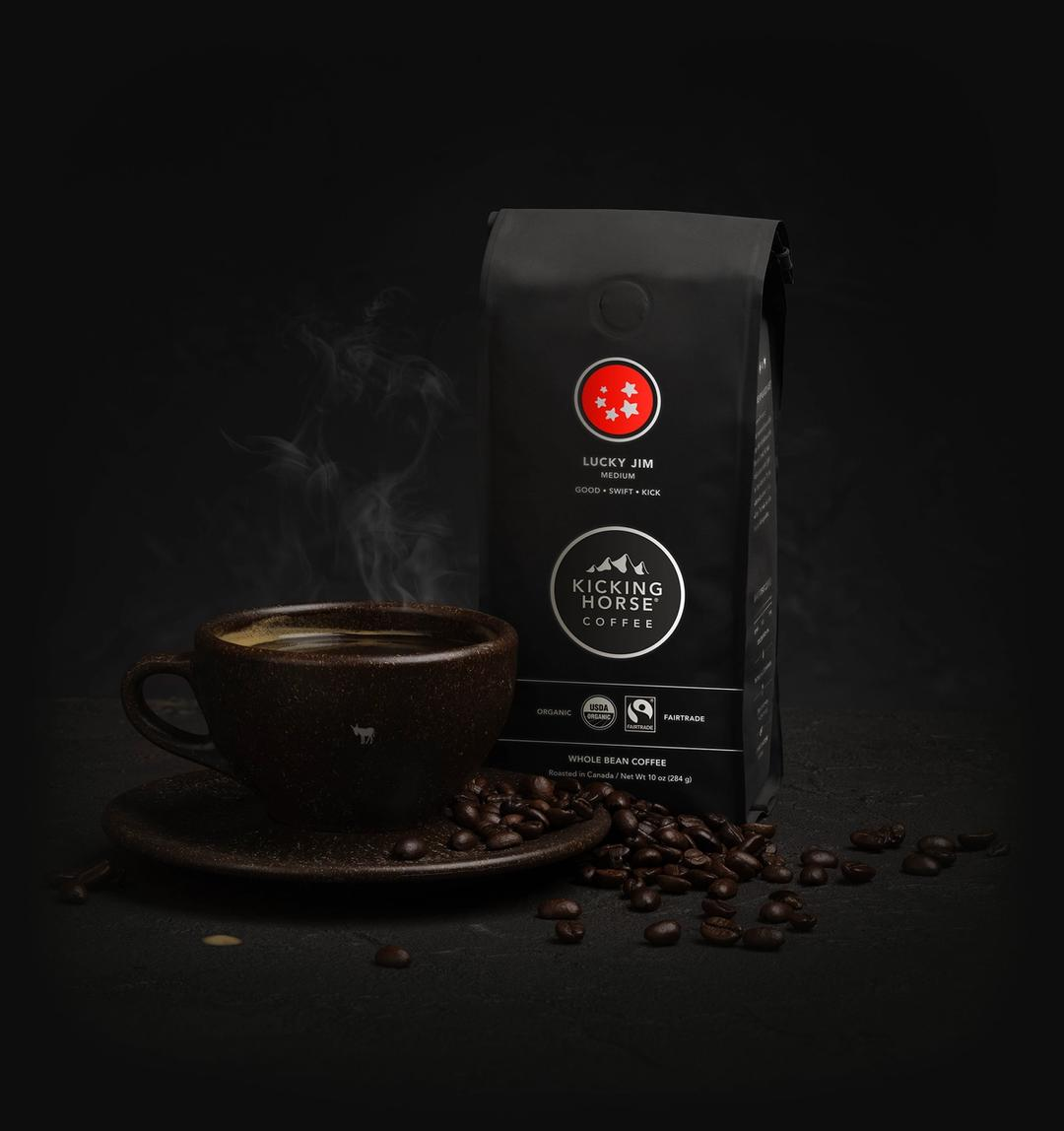 Lucky Jim Whole Bean coffee bag with cup of coffee and coffee beans
