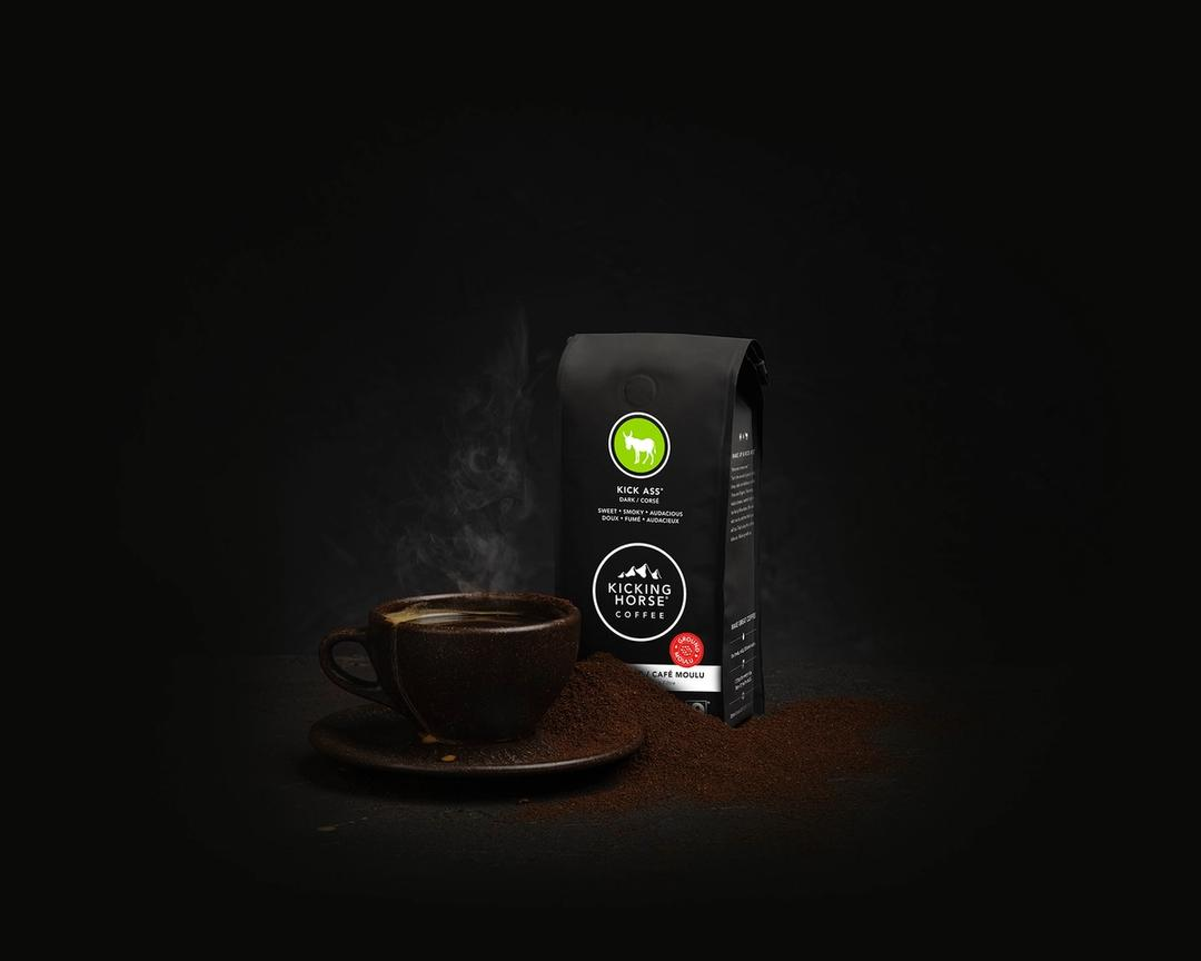 Kick Ass Cup of coffee by a bag of coffee