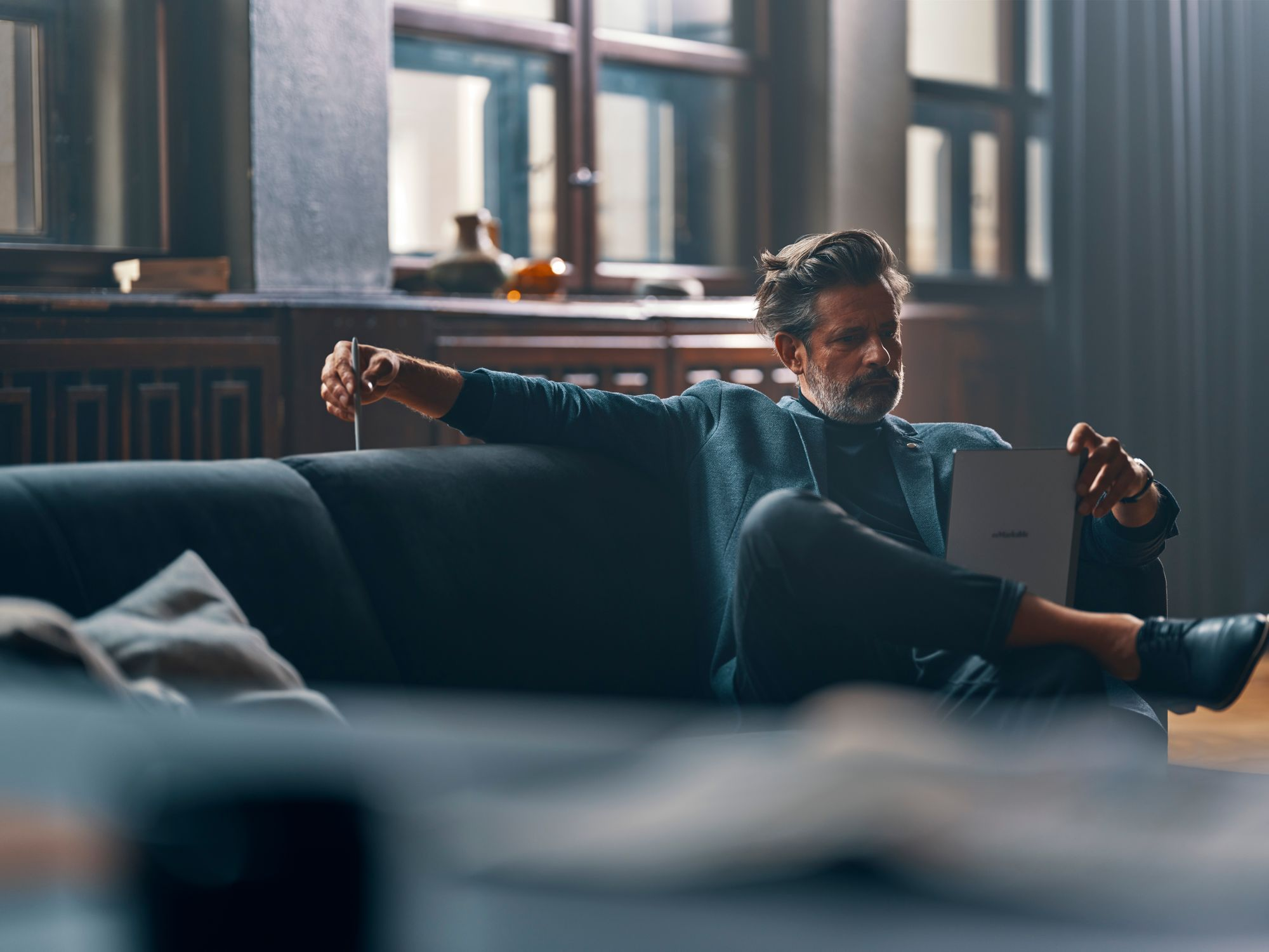 man in couch using remarkable 2