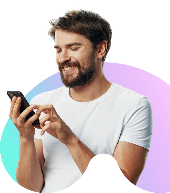 Man using  a mobile phone and smiling in front of a colourful background