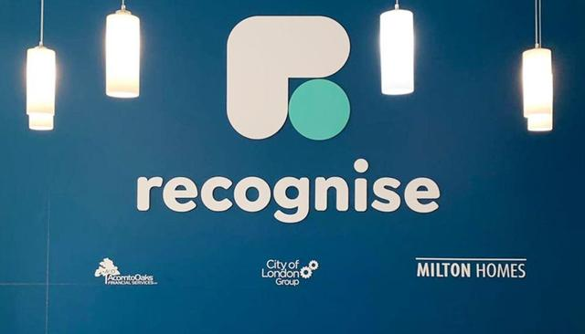 Recognise logo against blue wall.
