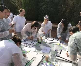 Team fun painting outdoors