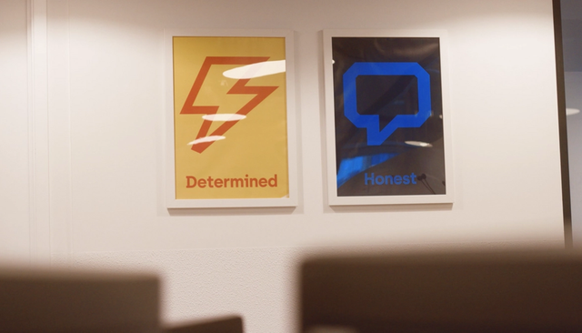 2 posters on a wall, one says determined and the other says honest