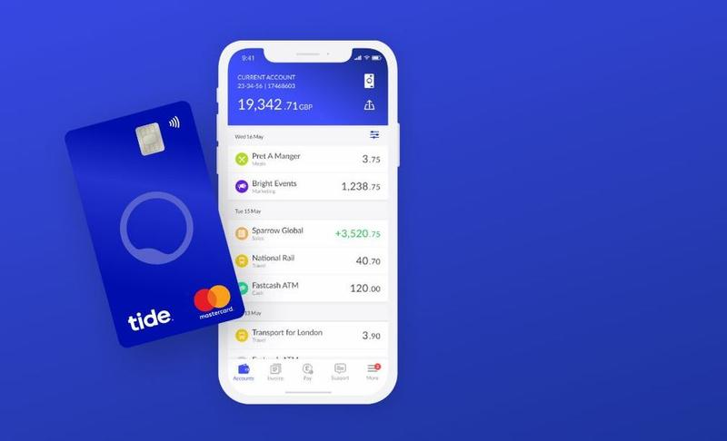 A Tide bank card sits next to a mobile phone showing the Tide app.