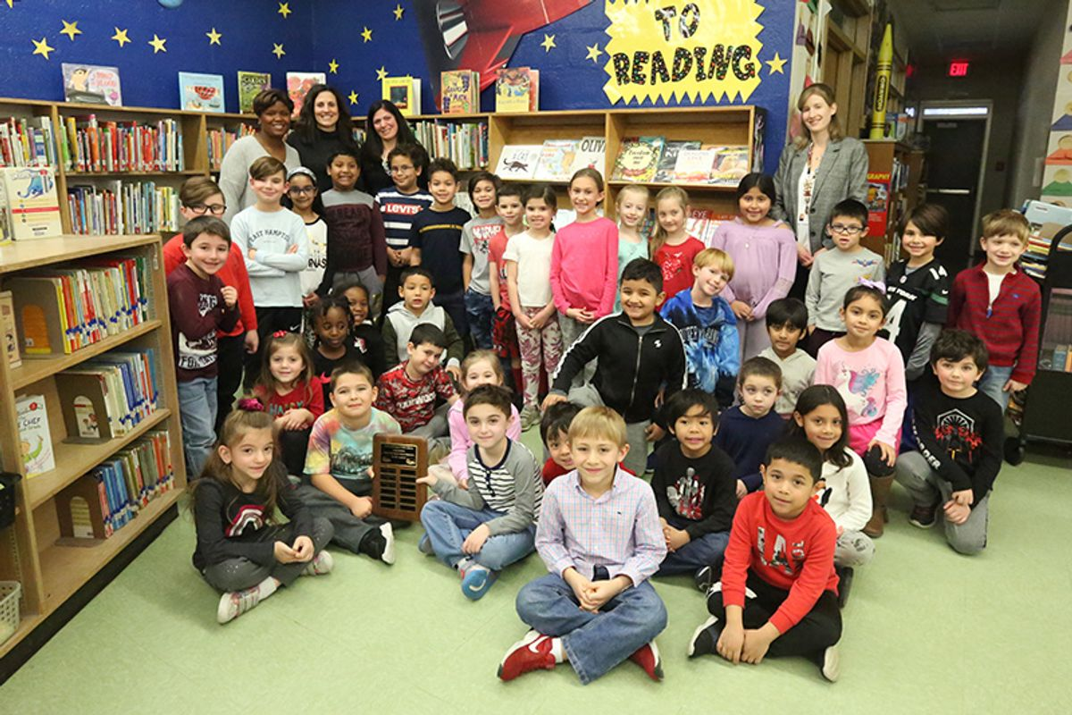 Image of Oakwood students with representative from South Huntington Public Library