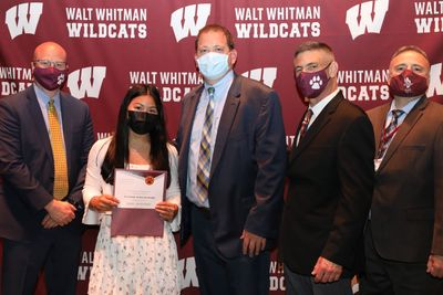 (left to right) Superintendent of Business and District Operations, Dr. Vito D'Elia, Principal Dr. John Murphy, Superintendent of Schools, Dr. Dave Bennardo, and Deputy Superintendent of Instruction and Curriculum, Dr. Joe Centamore, congratulated over 50 of Walt Whitman's PTA Scholarship Award recipients, including Salutatorian Grace Buckshaw pictured above.