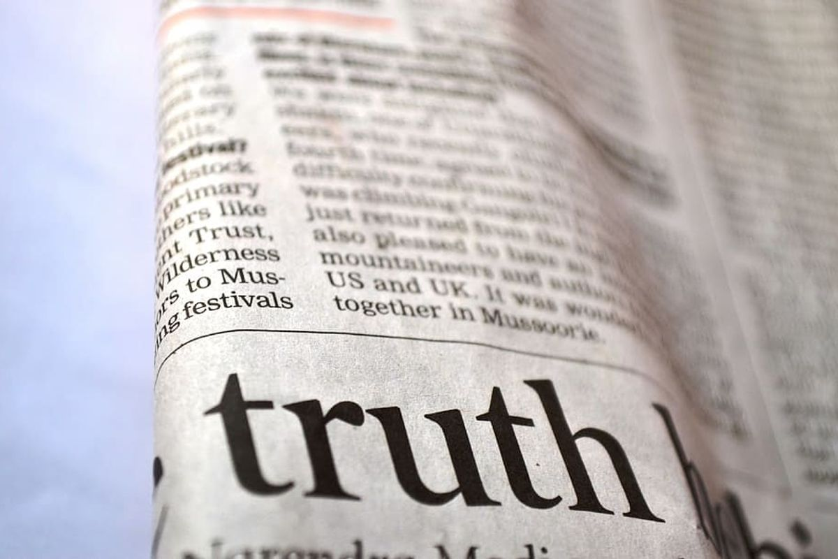 Image of the word 'truth' on printed paper