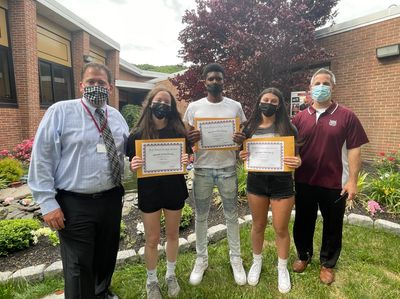 Principal Dr. Murphy and Assistant Principal Mr. Varlamos present and congratulate Walt Whitman's Athletes of the Month for May (left to right): Judy Anest, Chris Davis, and Allie Fink.