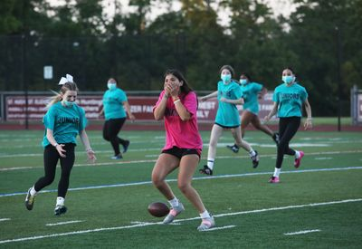 The junior and senior girls took over Walt Whitman's turf for the annual Powder Puff football game, just in time for the end of the school year.