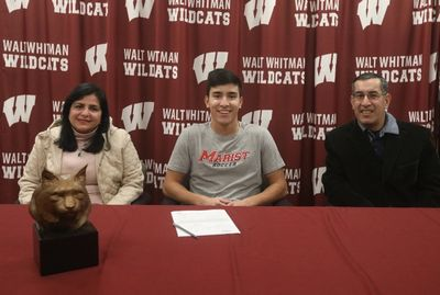 Rich Morel is joined by his parents as he commits to play soccer at Marist College next year.