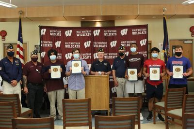 Members of the American Legion Post 1244 share their thanks as they congratulate Whitman's brave young men who have committed to serving in the United States Military.