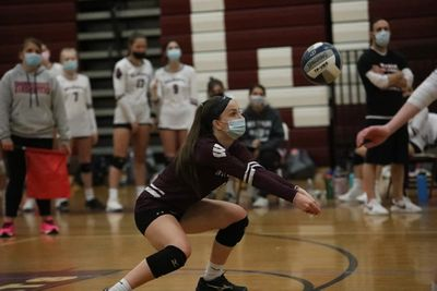 Senior Maggie Neiland had 14 digs and 3 aces in Saturday's semifinal against Bellport.