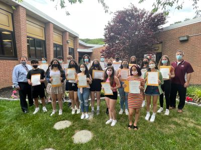 Principal John Murphy (left) and Assistant Principal Jon Varlamos (right) congratulate their May Students of the Month.