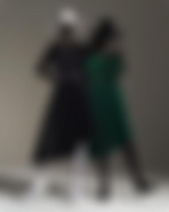 Models wearing black and green dresses
