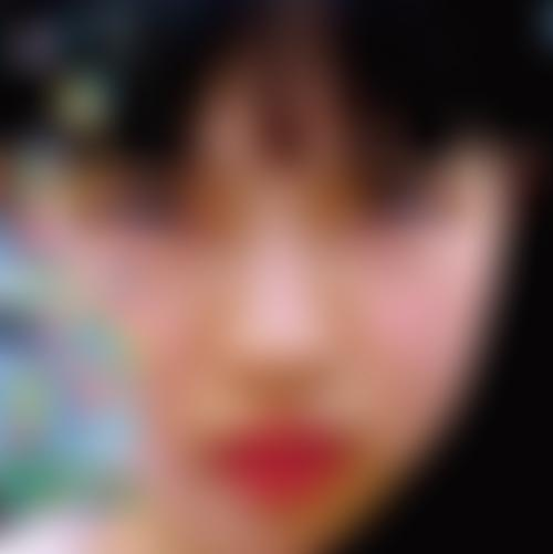 A girl is photographed in Japan with animated drawings overlayed