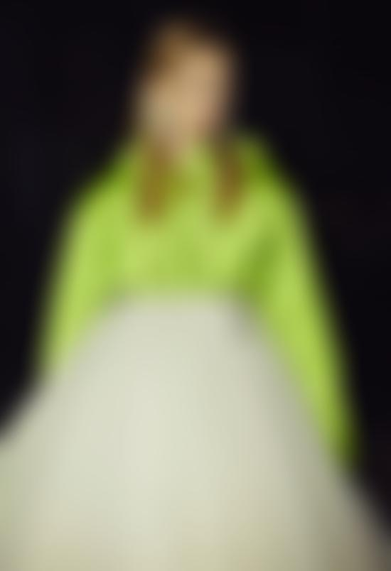 Model in lime green anorak and tutu