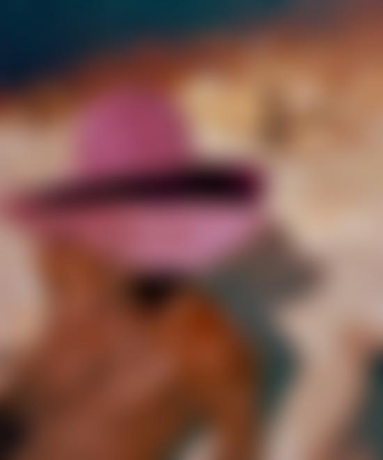 Man in pink hats on the beach