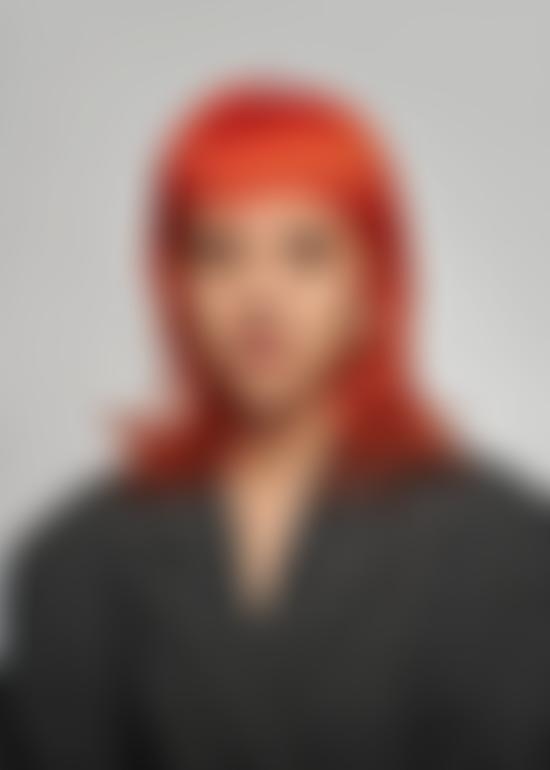 Girl wears blazer with bright red hair
