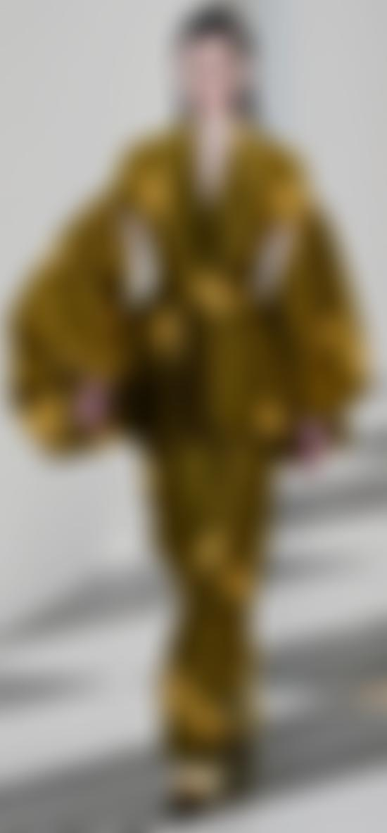 Model in abstract khaki suit with yellow swirls