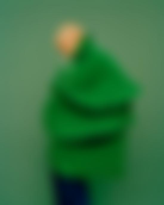 A woman in a green fringed coat