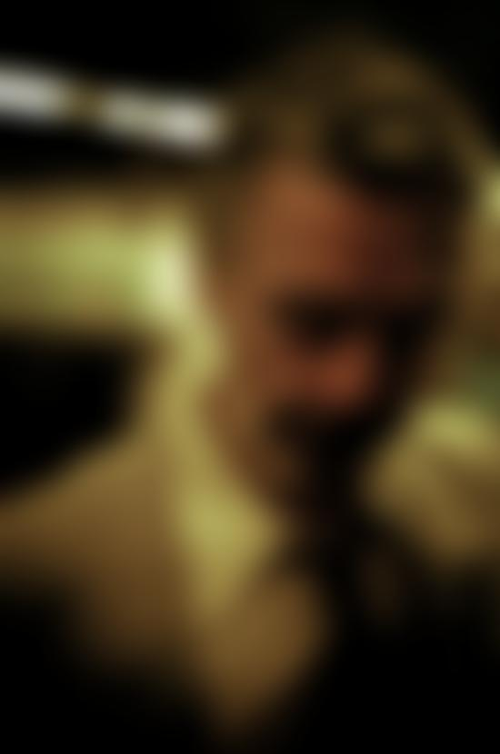 Close up shot of Baxter Dury on the subway platform