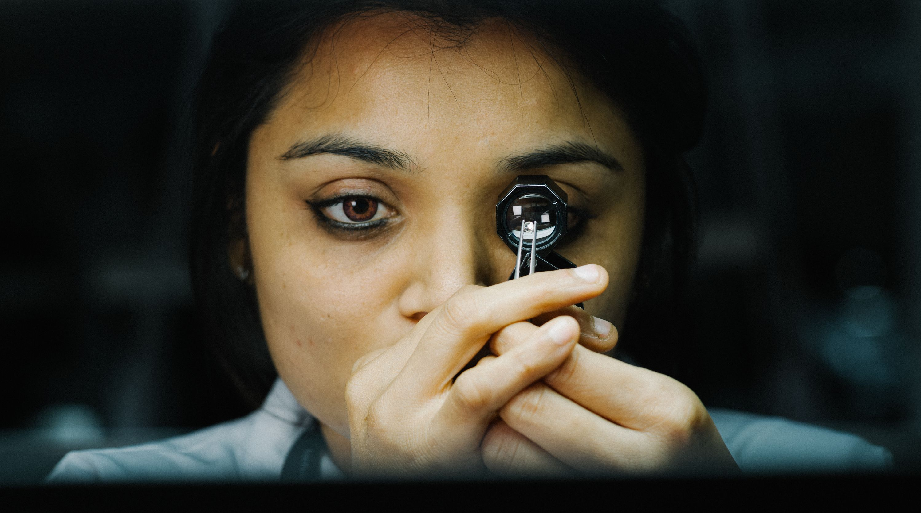 Woman examining a diamond