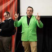 Man in green coat leading trivia