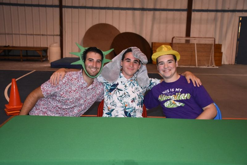 three young men in funny costumes