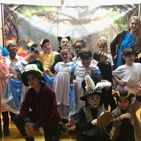 children in costume after performance of Alice in Wonderland Jr.
