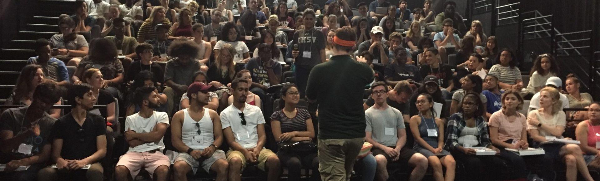 Teacher engaging a group of staff