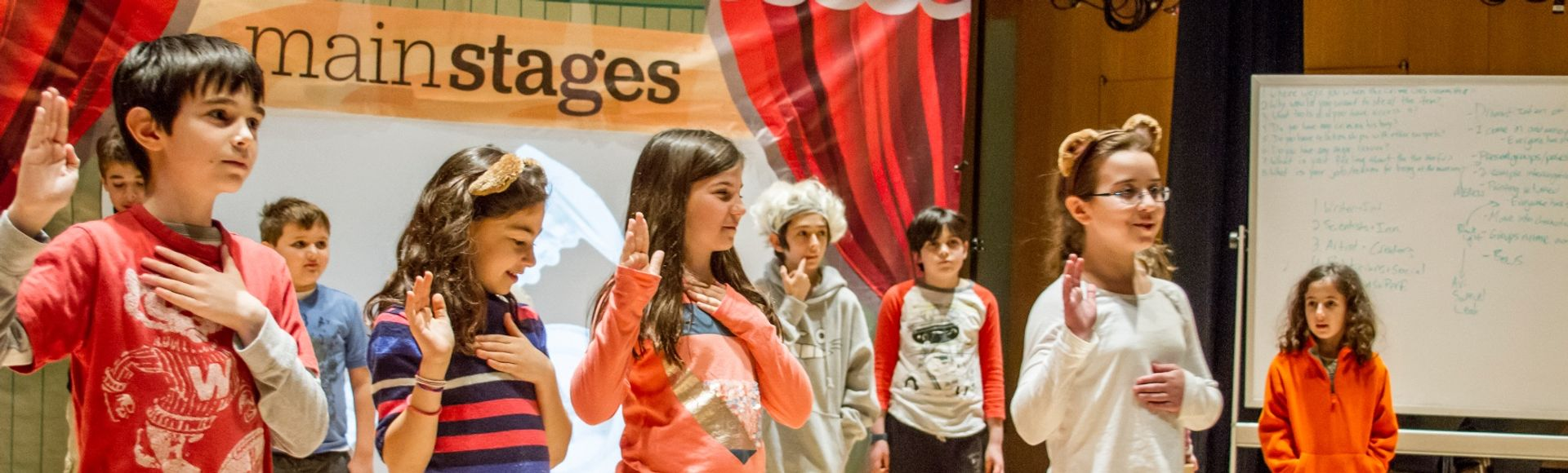 children during mainstages theater performance