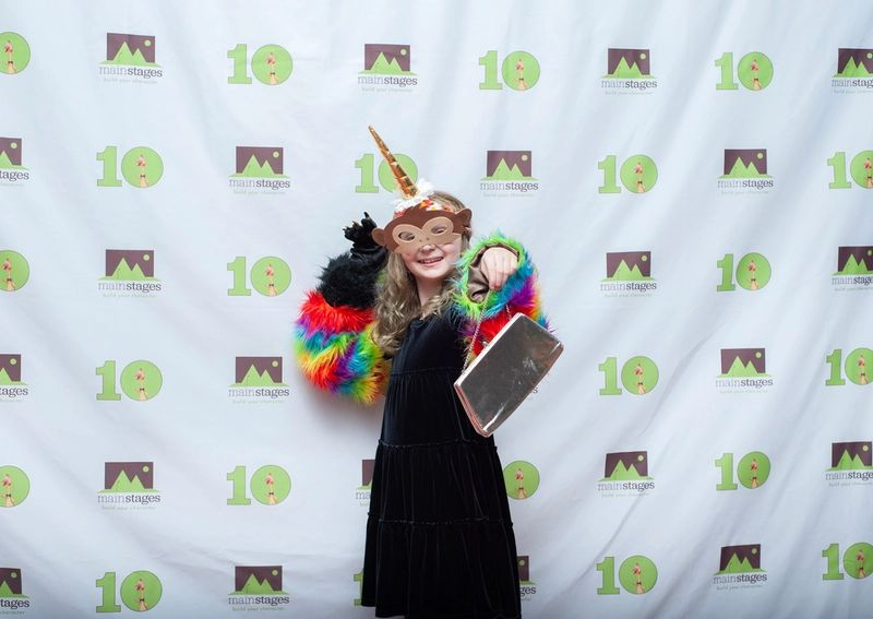 happy kid at an event with a costume on