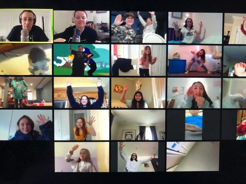 kids on zoom class having fun raising hands