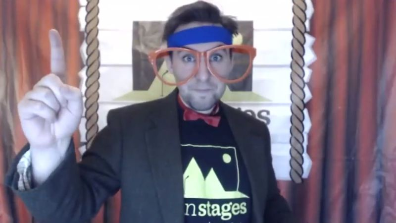 performer wearing a bow tie and oversize glasses
