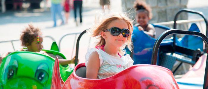 Small girl riding fish ride at DelGrosso's Park