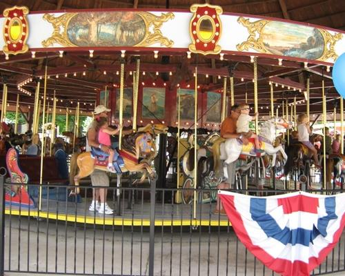 Families riding on the Antique Carouselle at DelGrosso's Park