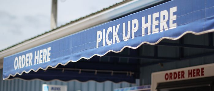 Order and Pick Up Here signs at Laguna Snacks concession stand