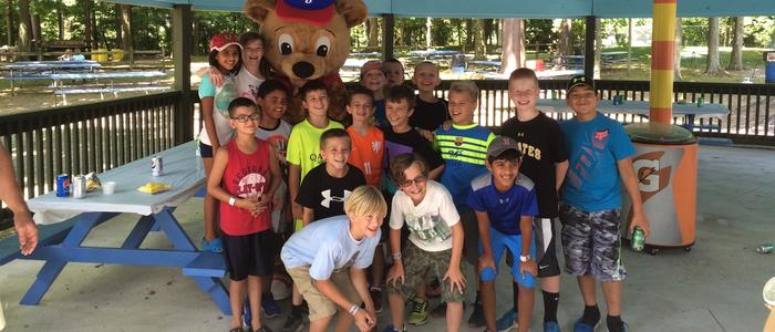 Children standing with Buddy Bear at DelGrosso's Park