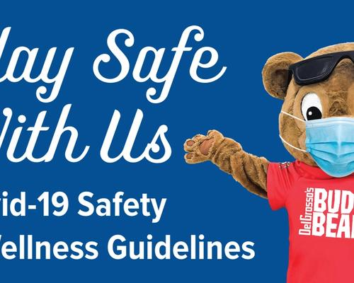 DelGrosso's Mascot Buddy Bear with mask on pointing to Play Safe With Us text