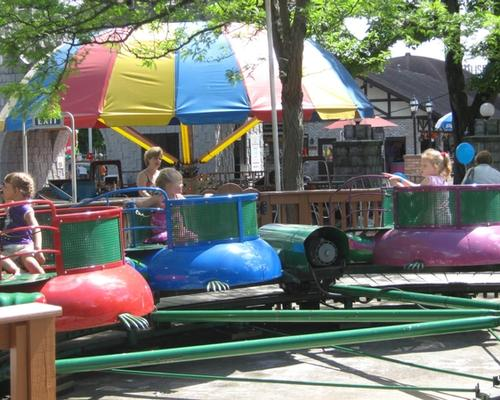 Kids riding the Turtles Kiddie Ride at DelGrosso's Amusement Park