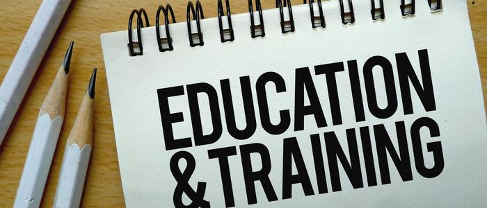 Notebook that says Education and Training