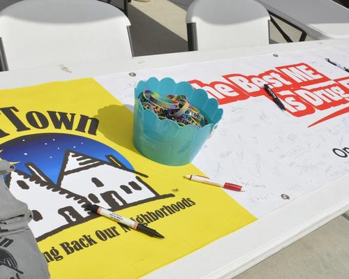 Image of Operation Our Town Shirts and Banner