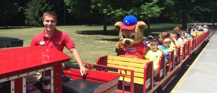 Children riding the Train at DelGrosso's Park with Buddy Bear